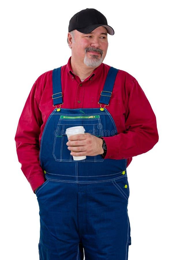 Fazendeiro ou trabalhador pensativo que olham ao lado foto de stock