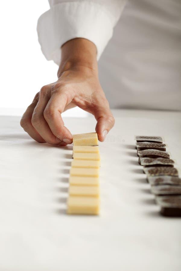 Fazendo chocolates foto de stock royalty free