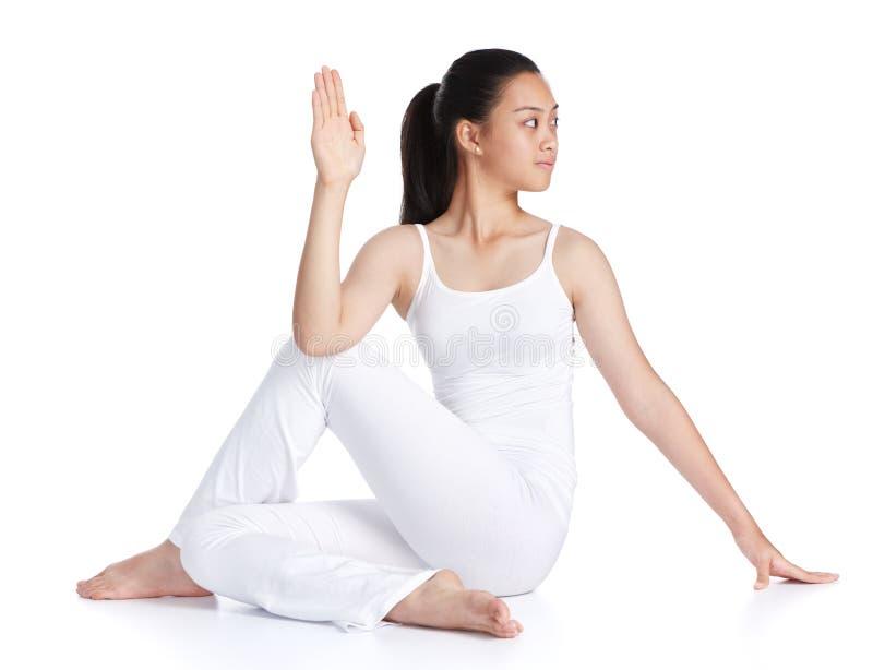 Fazendo a ioga fotografia de stock