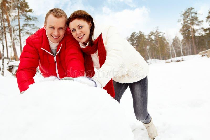 Fazendo o boneco de neve foto de stock