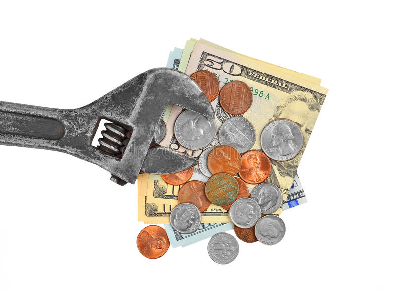 Fazendo o dinheiro, o dólar e a chave foto de stock
