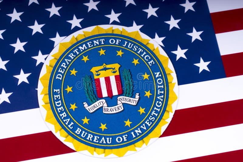 FBI Logo und die USA-Flagge lizenzfreie stockfotografie