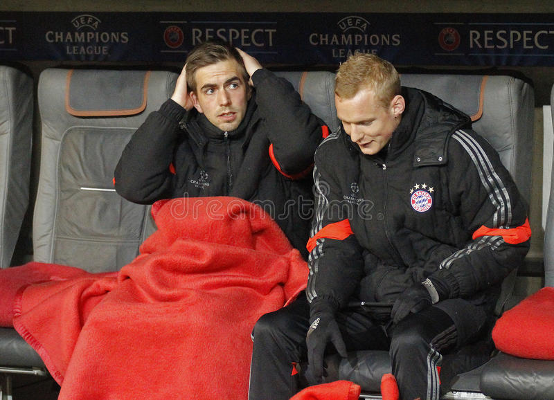 FC Bayern Muenchen v FC Shakhtar Donetsk - UEFA Champions League. MUNICH, GERMANY - MARCH 11 2015: Bayern Munich's defender Philipp Lahm on the substitutes bench royalty free stock photography