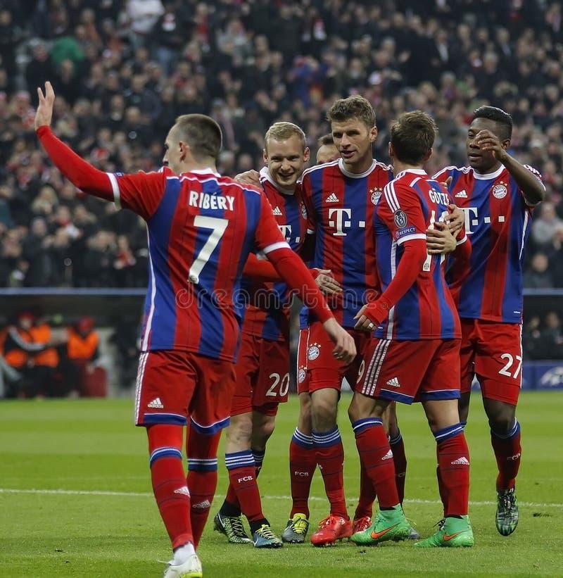 FC Bayern Muenchen v FC Shakhtar Donetsk - UEFA Champions League. MUNICH, GERMANY - MARCH 11 2015: Bayern Munich's forward Thomas Muller celebrates scoring a stock image