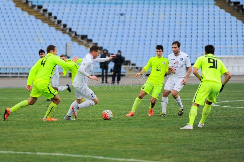FC Stal versus FC Olimpik stock afbeelding
