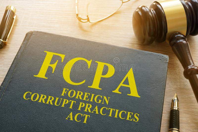 FCPA Foreign Corrupt Practices Act on a desk. FCPA Foreign Corrupt Practices Act on a wooden desk stock photos