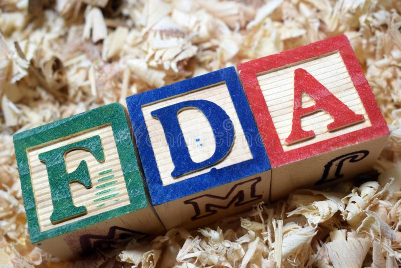 FDA Food and Drug Administration acronym on wooden blocks. Food and Drug Administration acronym on wooden blocks business and financial terminologies royalty free stock image