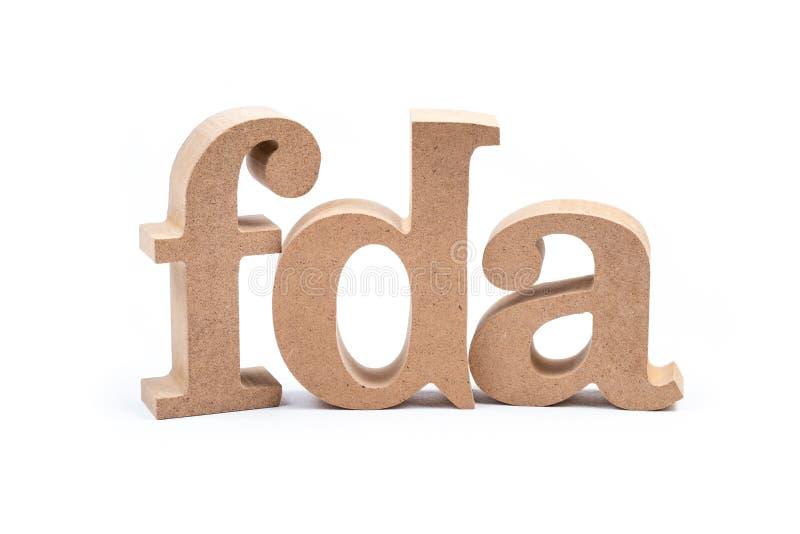 FDA Alphabet Isolated Food and Drug Administration. FDA wood alphabet isolated on white background, abbreviation of Food and Drug Administration stock photos