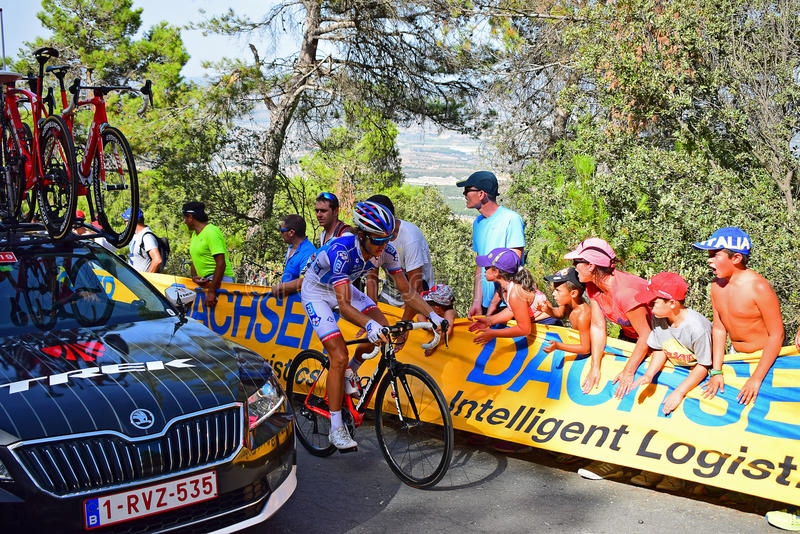 FDJ Rider Passed By Trek Team Car La Vuelta España Cycle Race. Car and rider near the mountain top finish in the 2017 La Vuelta Espana bike race royalty free stock photos