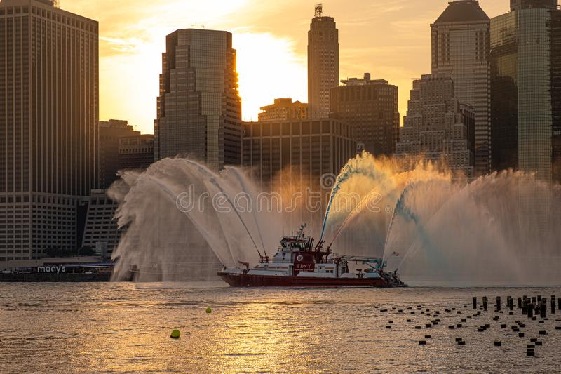 FDNY boat sprays red, white, and blue water ahead of Macy`s 4th of July Fireworks stock photography
