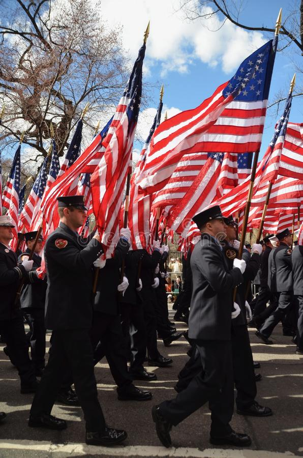 FDNY 343. The Fire Department of New York memorial for 343 firefighters who fell at the World Trade Center on 9/11 marching in the Saint Patrick`s Day Parade in stock images