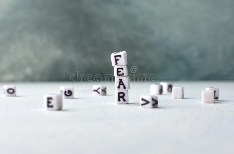 Fear concept with cubes. And letters. Copy space royalty free stock photos