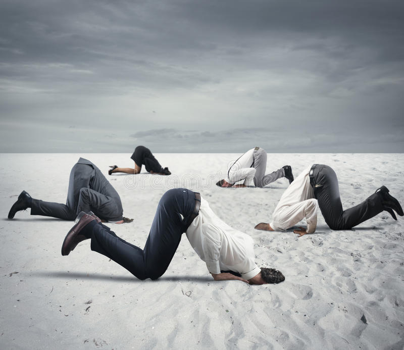 Fear of crisis with businesspeople like an ostrich. Afraid business people hide their head under the ground like an ostrich. Fear of crisis concept royalty free stock photos