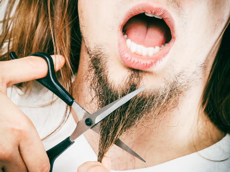 Fear of cutting beard stock photography