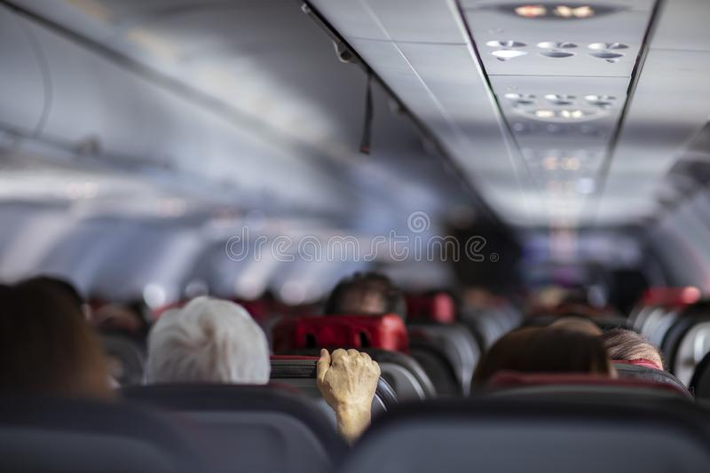 Fear of flying airplanes. Hand holding airplane seat. royalty free stock photos