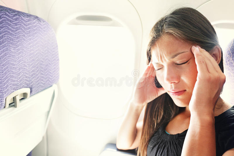 Fear of flying woman in plane airsick stock image