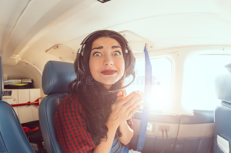 Fear of flying woman stock image