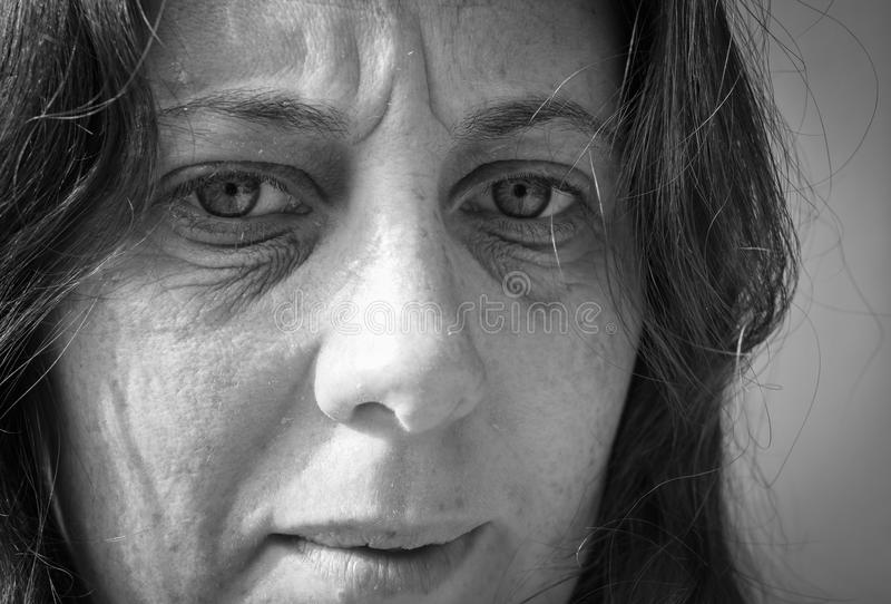 Fear, loneliness, depression, abuse. This woman is in fear and has depression caused by the abuse and addictions that she suffers from stock photography