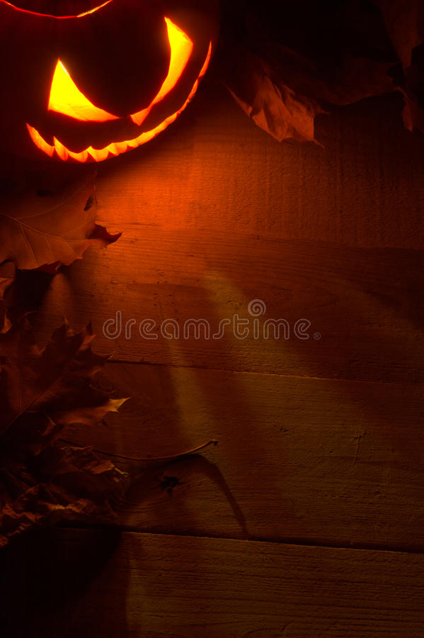 Fearful halloween red shadows background with lighting jack o lantern in the corner royalty free stock photos