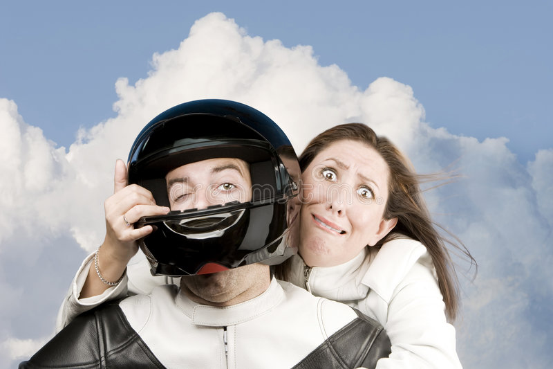 Fearful woman and man on a motorcycle