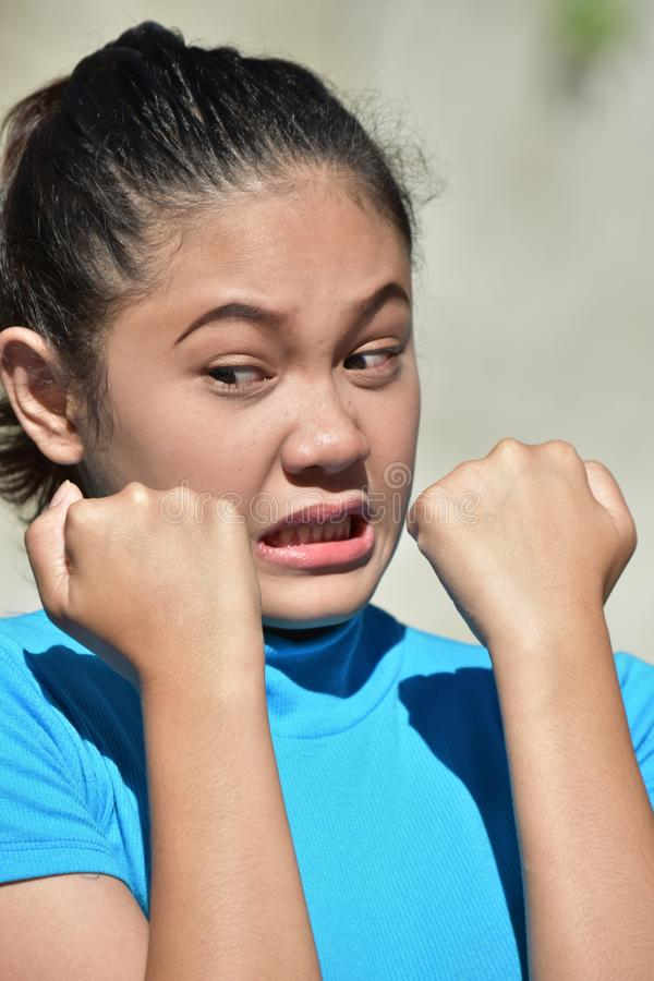 A Fearful Youthful Female. An attractive and asian person royalty free stock photos