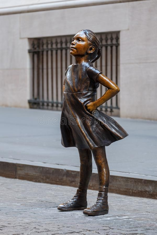The Fearless Girl statue at The New York Stock Exchange NYSE building stock image