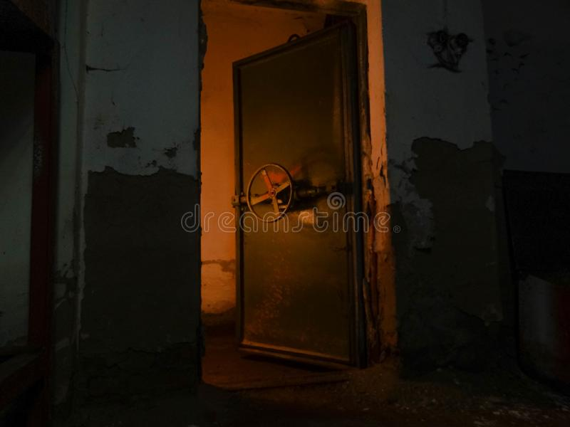 Fears of the cold war. The Soviet Union feared the beginnings of a third world war. To survive during such a war, people built shelters. This hermetic door stock photo