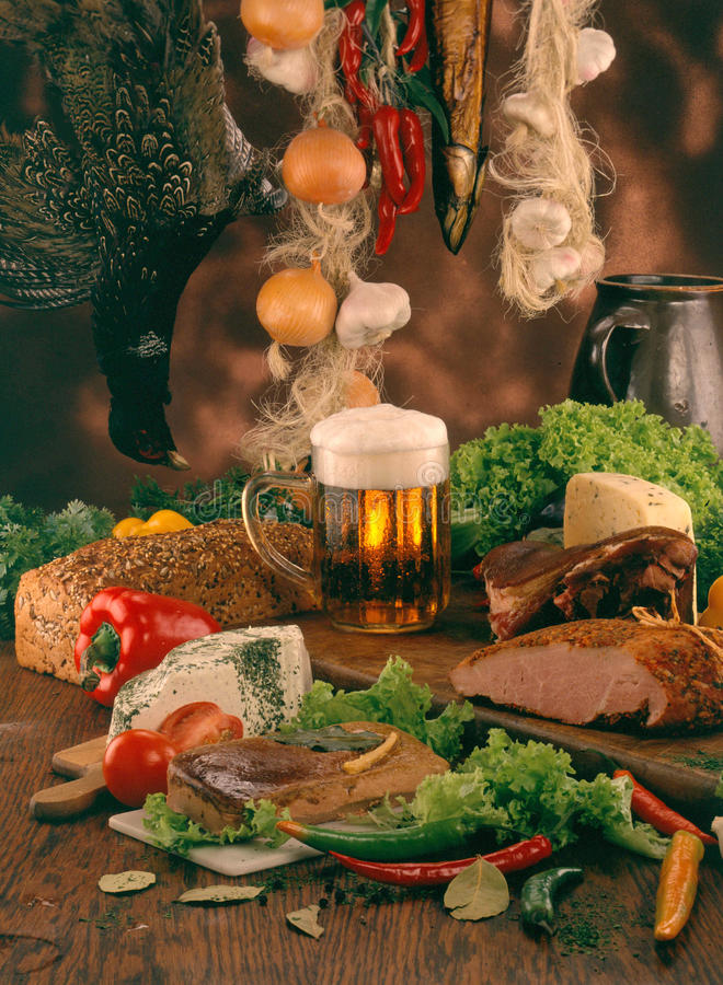 Food for a large feast. Assortment of different food, drinks and ingredients for a luxurious feast royalty free stock image