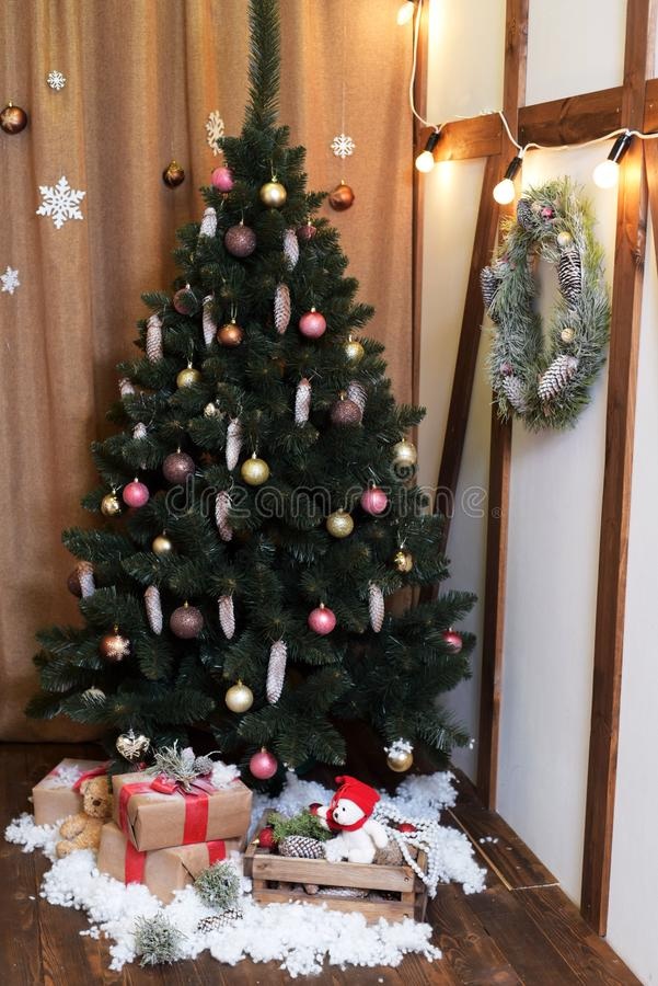 Feast of Christmas. Beautifully decorated house with a Christmas tree ipodarkami underneath royalty free stock images