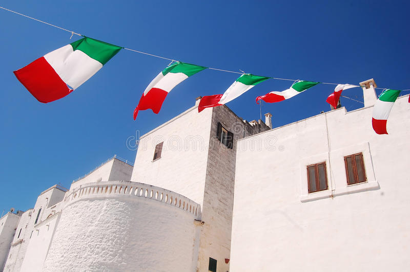 Feast in Ostuni the white city of Murgia in Puglia - Italy. Feast in Ostuni the white city of Murgia in Puglia - Tricolor flags in celebration in the city of stock images