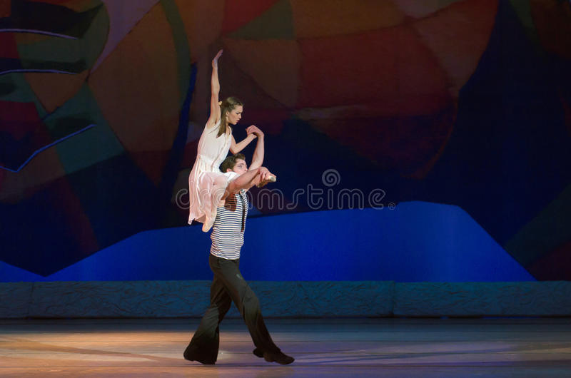 Feast on pointe. DNIPROPETROVSK, UKRAINE - MAY 30: Dancers Elena Saltykov and Eugene Kuchvar perform LADY AND THE HOOLIGAN at State Opera and Ballet Theatre on royalty free stock image
