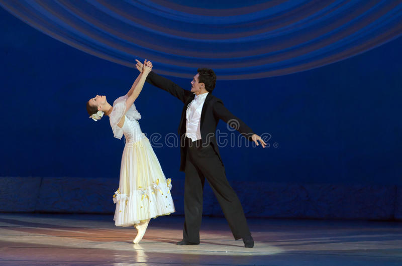 Feast on pointe. DNIPROPETROVSK, UKRAINE - MAY 30: Dancers Maria Lolenko and Yuri Voinikov perform The Great Waltz at State Opera and Ballet Theatre on May 30 stock photos