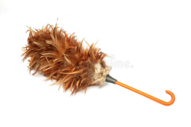 Feather duster for cleaning dust. Feather duster for cleaning dust isolated on white background royalty free stock images