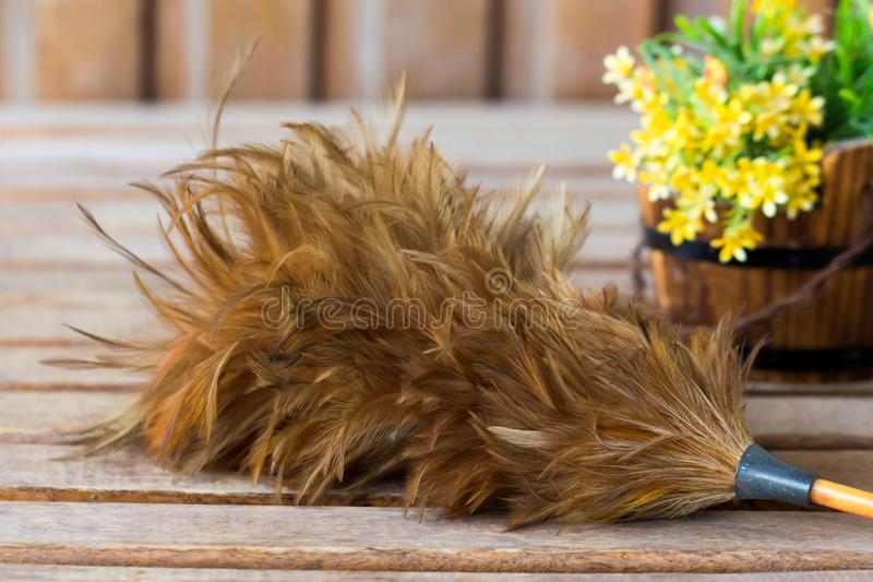 Feather duster on wooden table stock photo