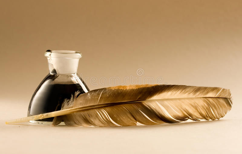 Feather and ink bottle royalty free stock images