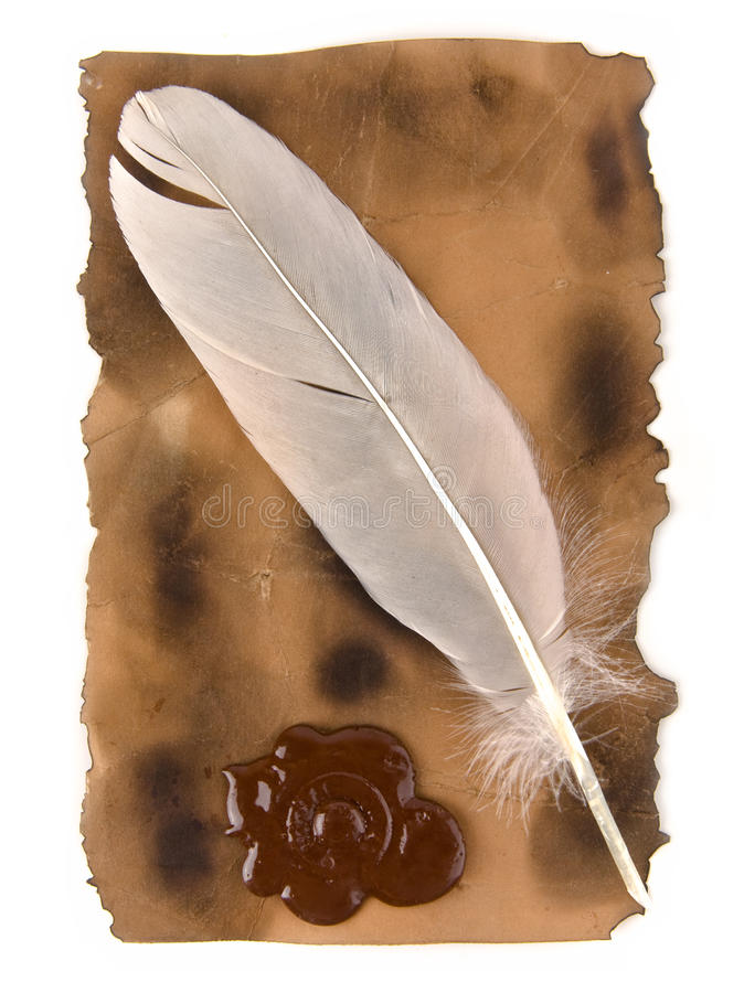 Feather and old paper stock photo