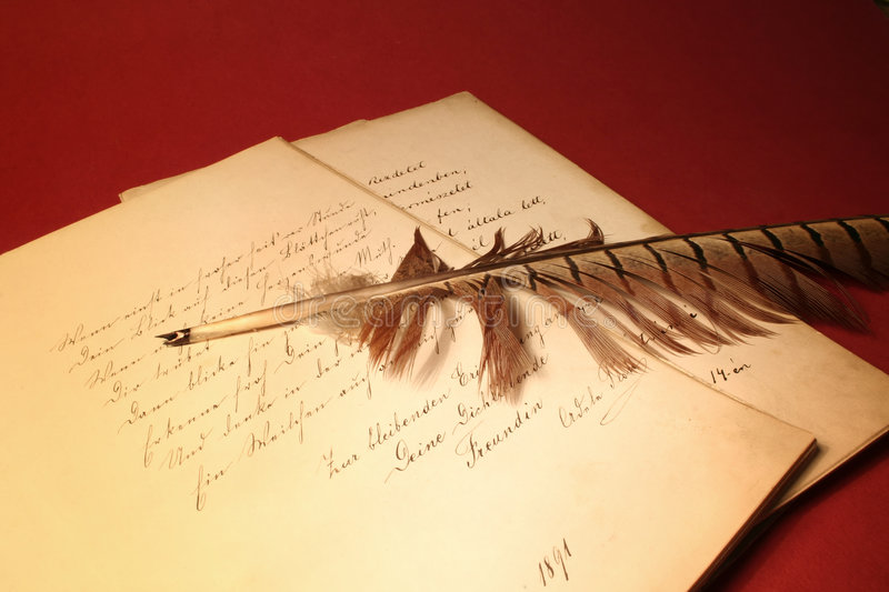 Feather on old papers royalty free stock photography