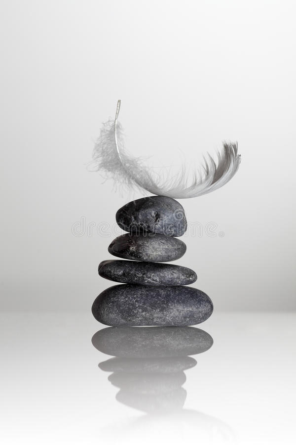 Download Feather over zen stones stock image. Image of closeup - 16597955