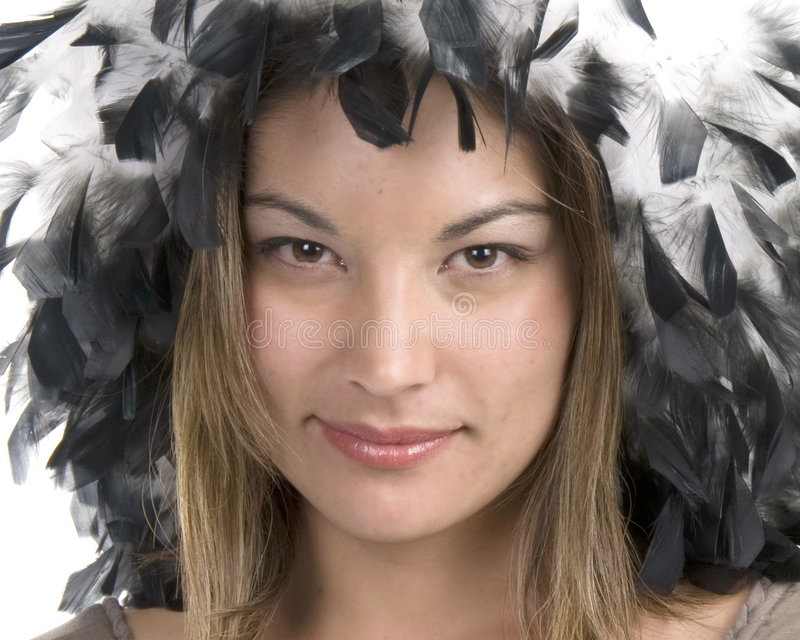 Feathered Hat. Beautiful model wearing white feather boa as a hat stock image