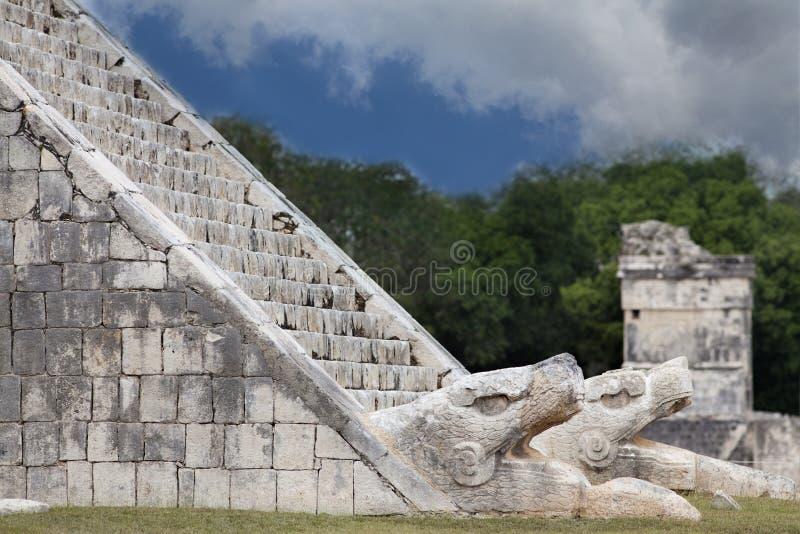 Feathered serpent at pyramid Kukulkan in Chichen Itza. Feathered serpent at the foot of pyramid Kukulkan in Chichen Itza stock photography