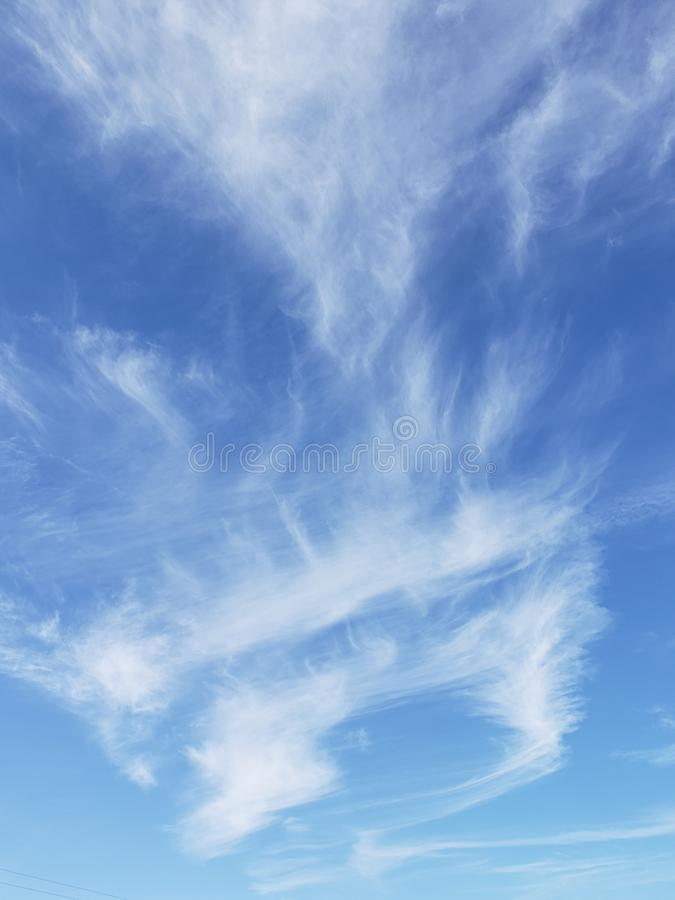 Feathers of autumn clouds in Ohio. Wisps of streaky thin clouds over Ohio fields royalty free stock image