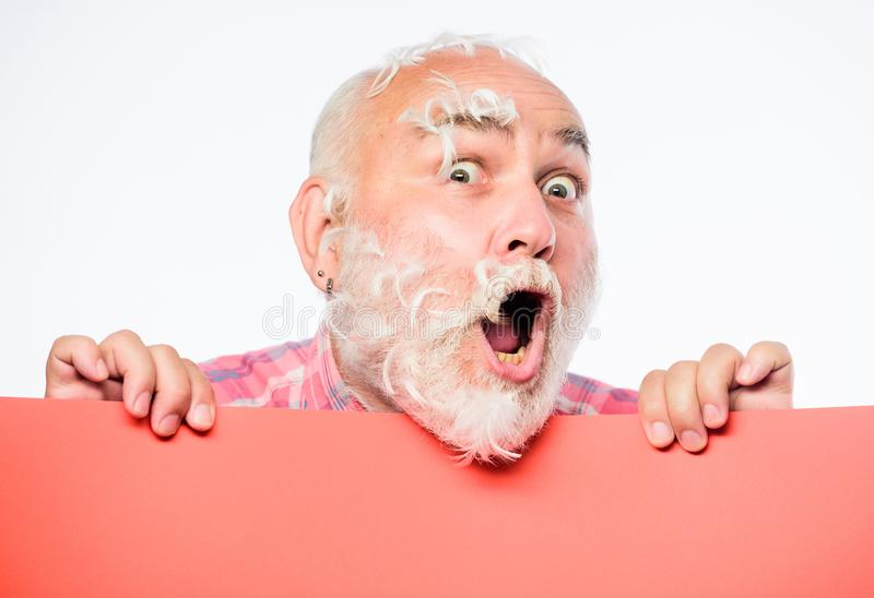 Feathers madness. Man bearded mature emotional face with stuck white feathers close up. Funny pensioner going crazy. Advertisement concept. Pillow party. Soft stock photos