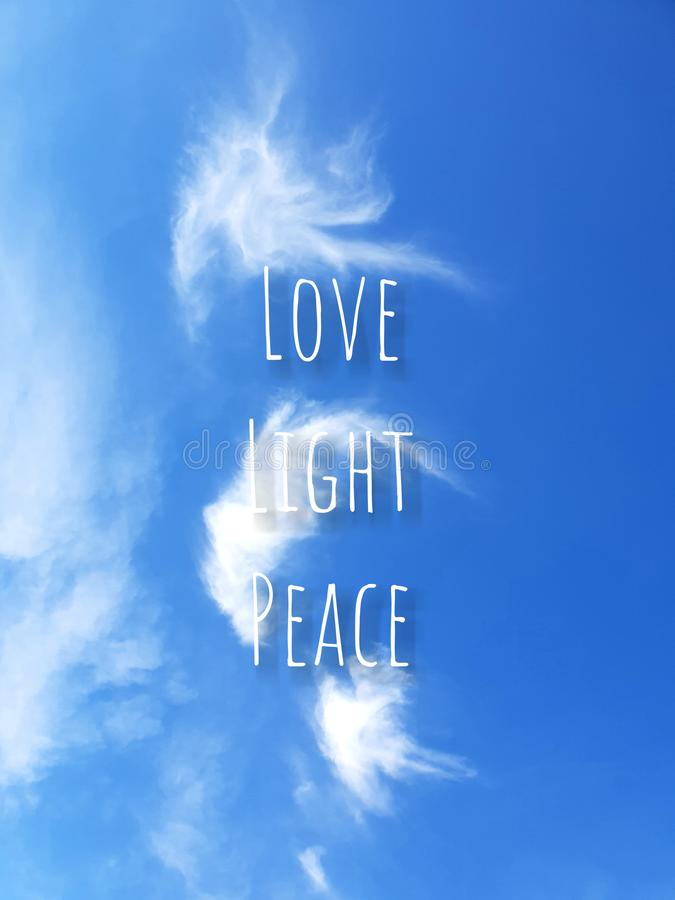 Love, light, peace, angelic cloud in shades of blue and white. Feathery angelic clouds, love, light, peace royalty free stock photo