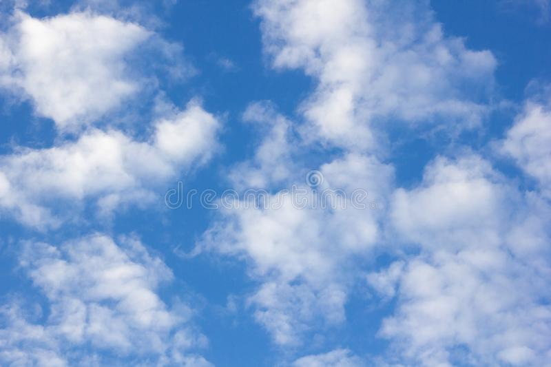 Feathery clouds in the blue sky stock photography