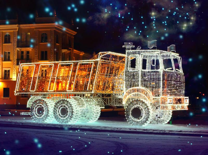 Feature Luminous Truck. A truck glowing with a multitude of light bulbs in Minsk, the capital of Belarus, Europe. Light decorations during Christmas and New Year stock image