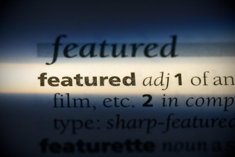 Featured. Word in a dictionary.  concept, definition stock photo
