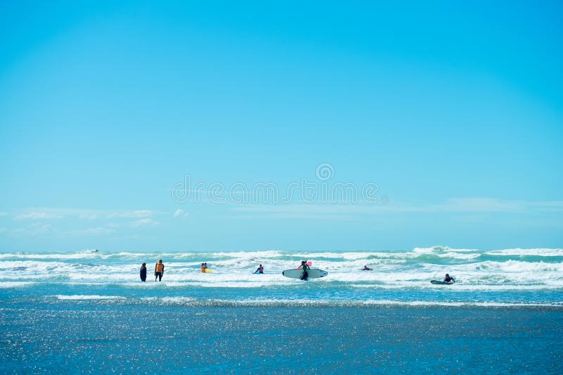 \'2018, FEB 4 - Christchurch, New Zealand, People enjoy their activities at the beautiful beach on a sunny blue sky day. I. \'2018, FEB 4 - Christchurch, New royalty free stock photography