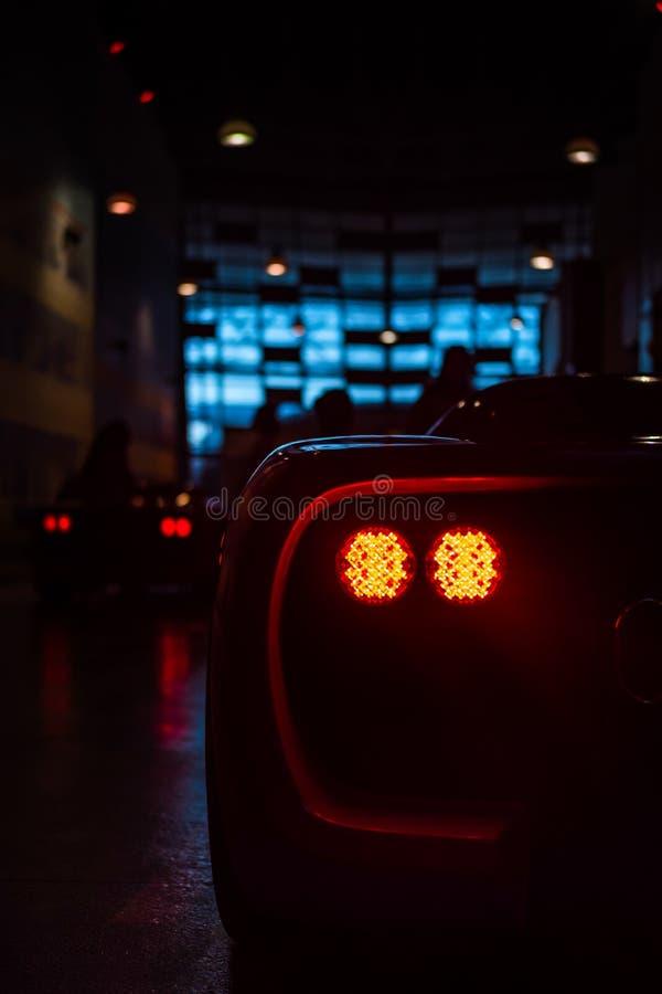 Feb 2, 2018: Hamulcowi światła Ferrari samochód w Ferrari Abu Światowym Dh obraz royalty free