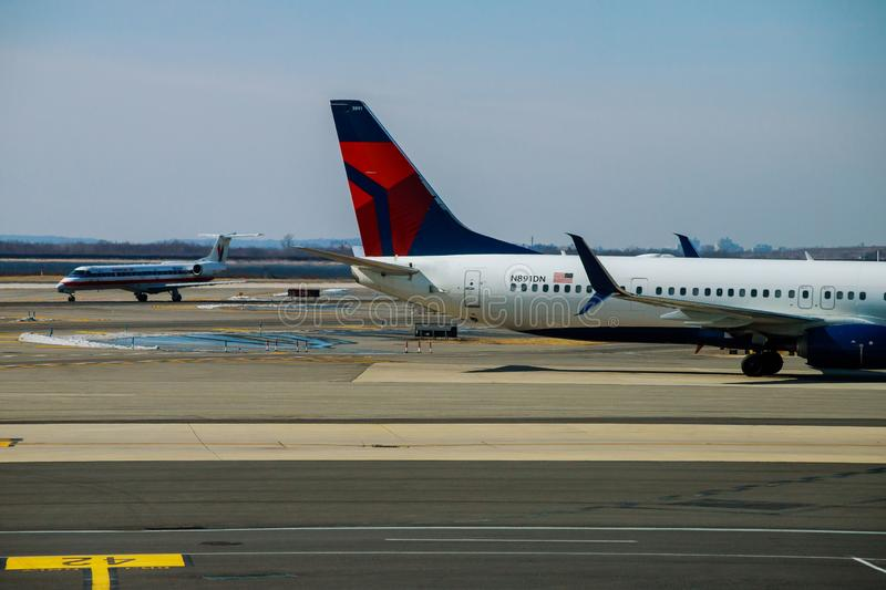FEB 14, 2019 JFK NEW YORK, USA: DELTA aircraft at the John F. Kennedy International Airport. It is the international air passenger. FEB 14, 2019 JFK NEW YORK royalty free stock images