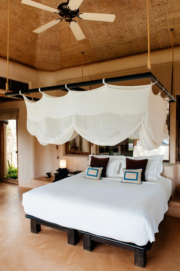 Tropical Resort Bedroom With Wooden Bed, Stylish Mosquito